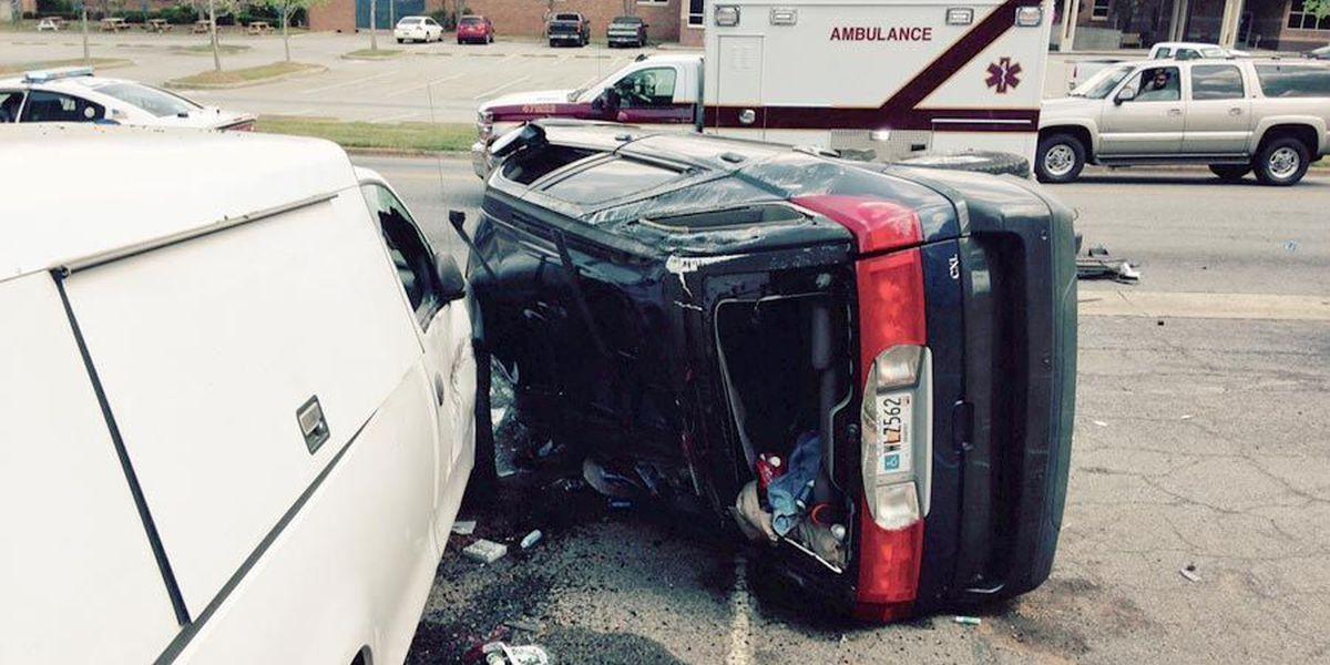 Wreck rolls car on its side