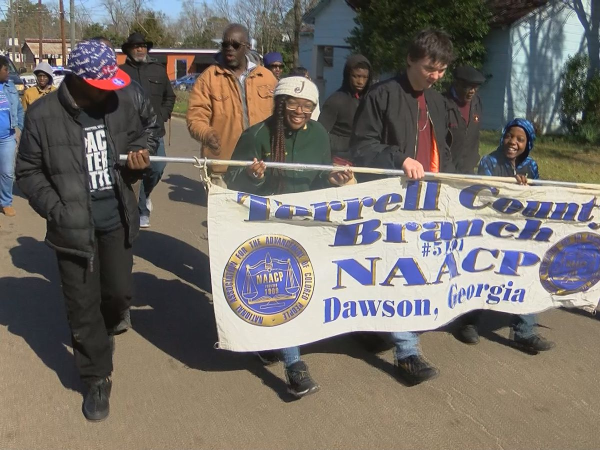 'To keep his dream alive': People in Dawson walk, sing in recognition of MLK
