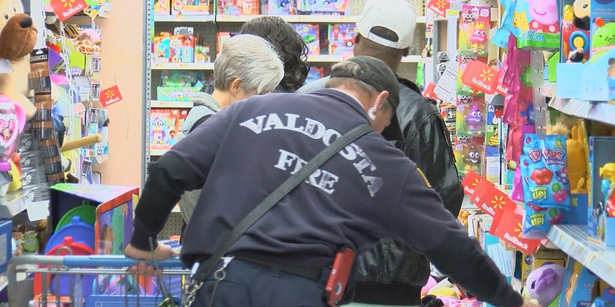 Valdosta disaster victims shop with a firefighter
