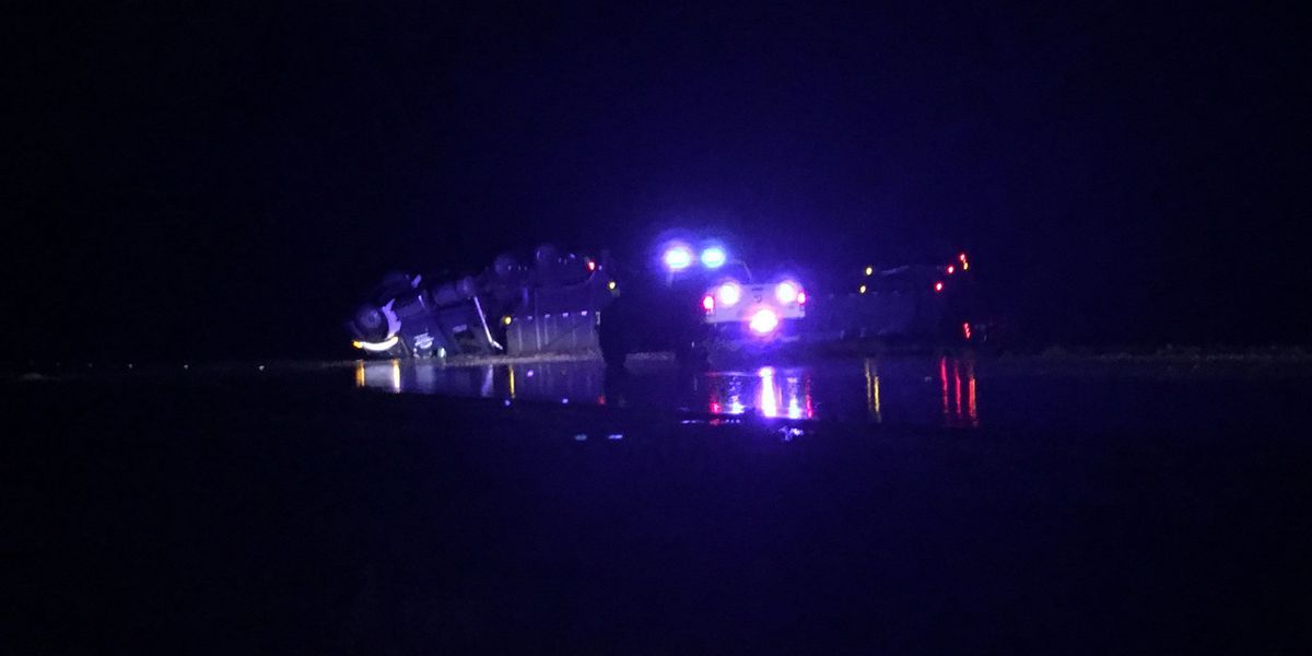 Overturned semi-truck blocks highway in Mitchell County