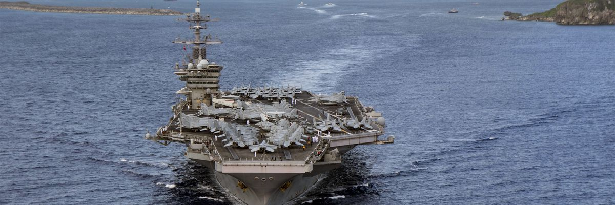 Navy carrier sidelined by virus is back operating in Pacific