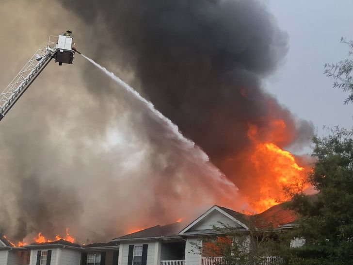 Apartment fire injures 3 firefighters, forces 11 families from their homes