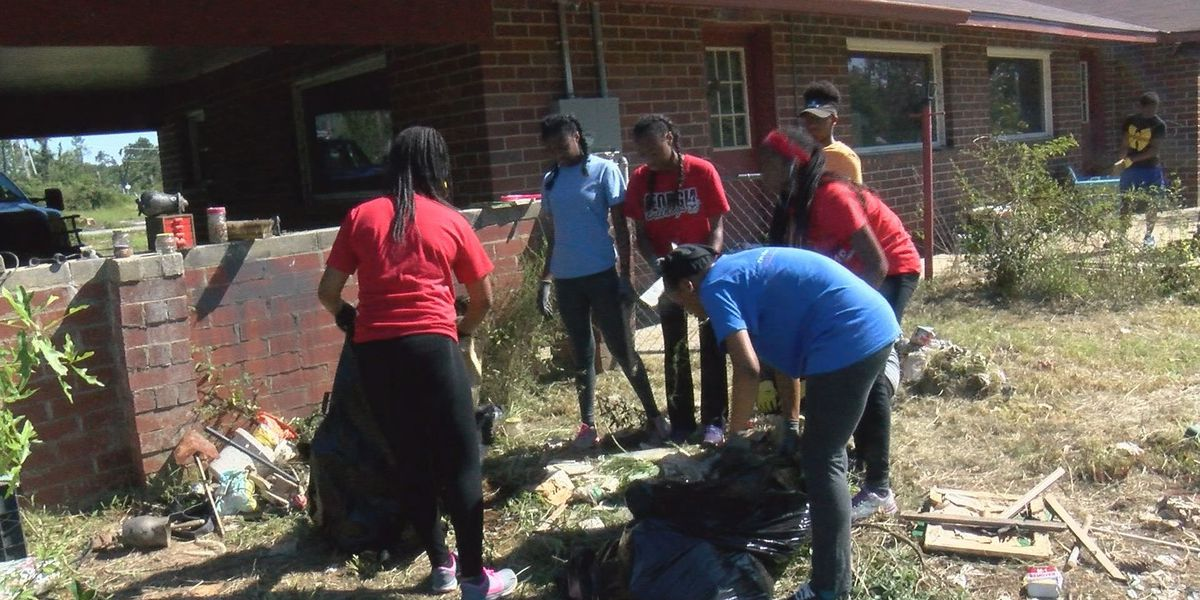 Youth group, rootball volunteers help grateful homeowner