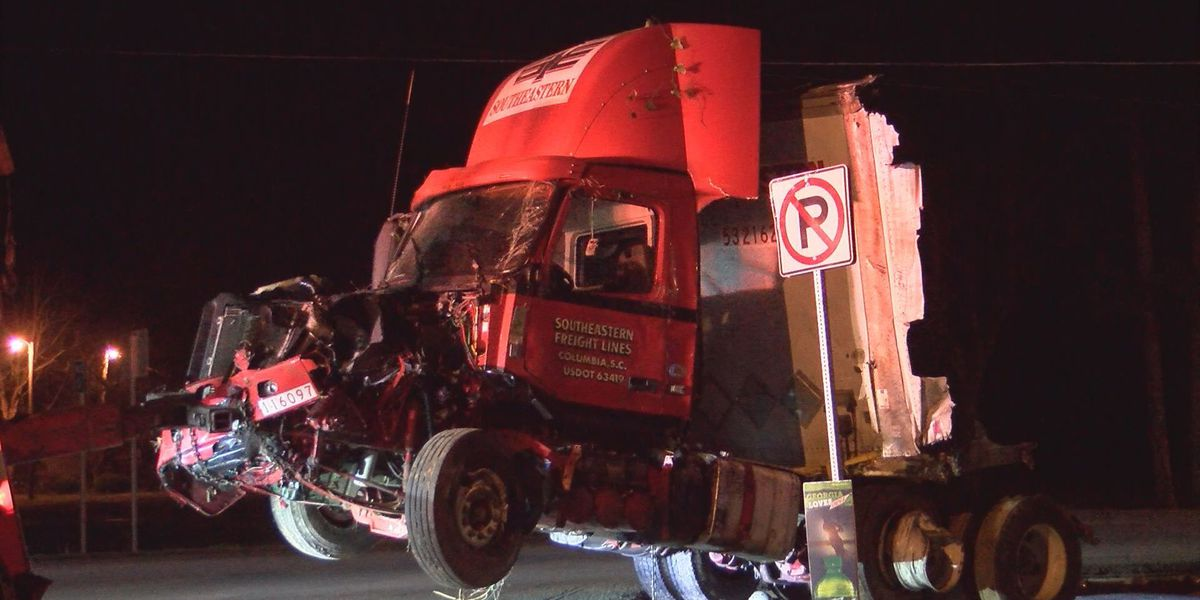 Truck driver hospitalized after swerving to avoid collision