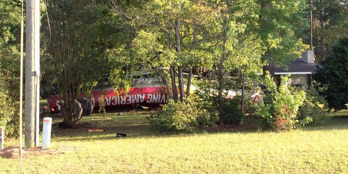 Fuel tanker overturns and leaves mess off US 82