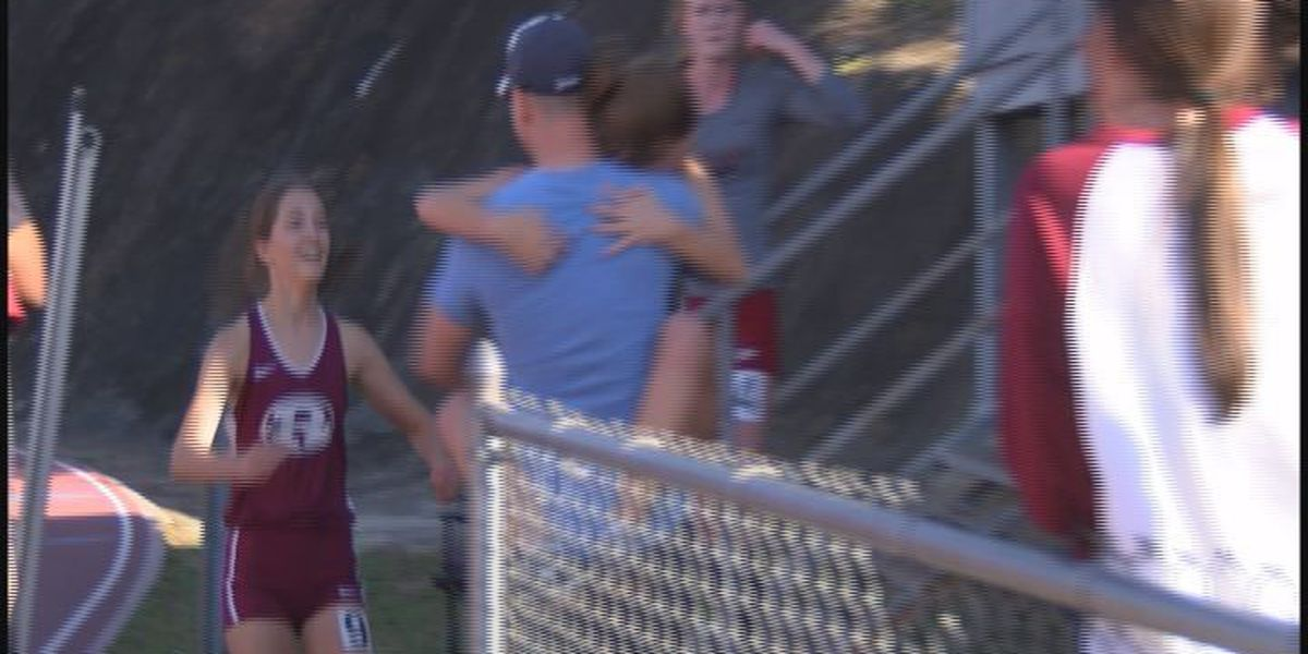 Military dad surprises daughters at Albany track meet