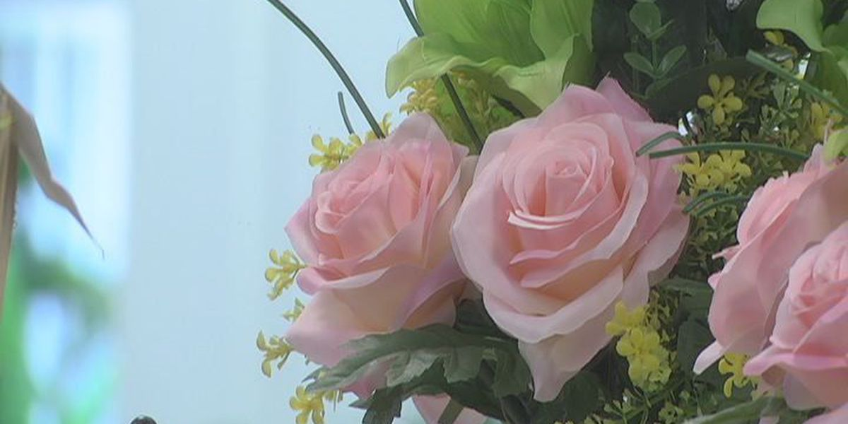 Albany flower shop owner's climb to success