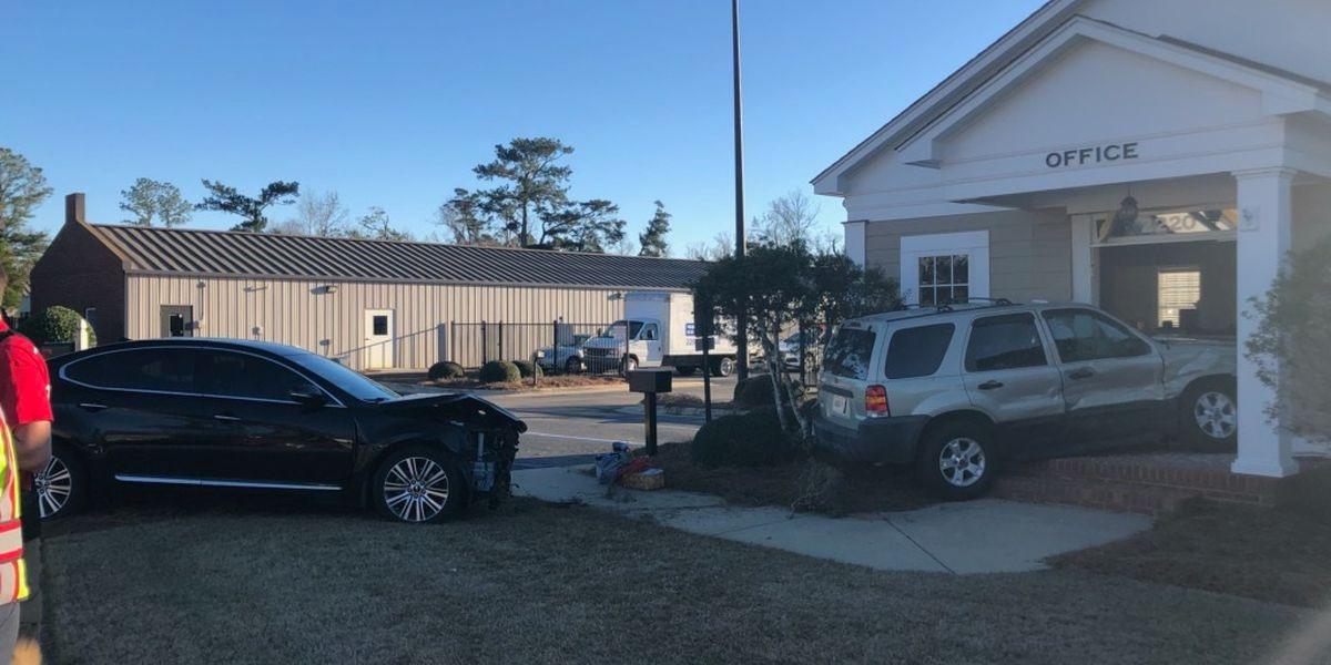 SUV runs into Albany business