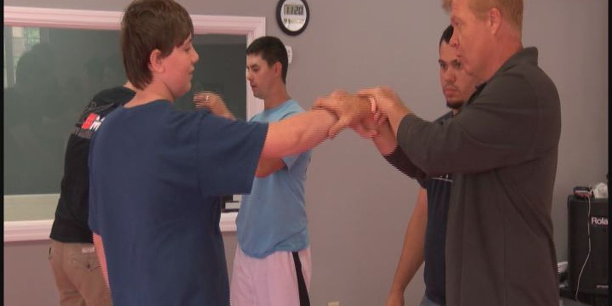Martial Art instructor host class to Lee County officials