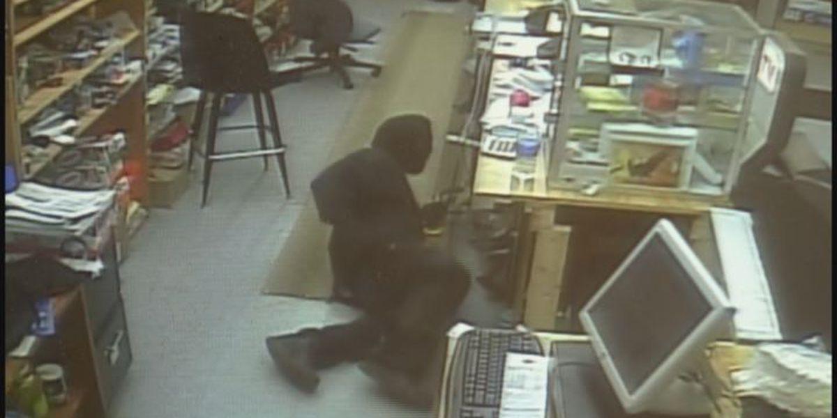 Surveillance video captures suspect crawling through store