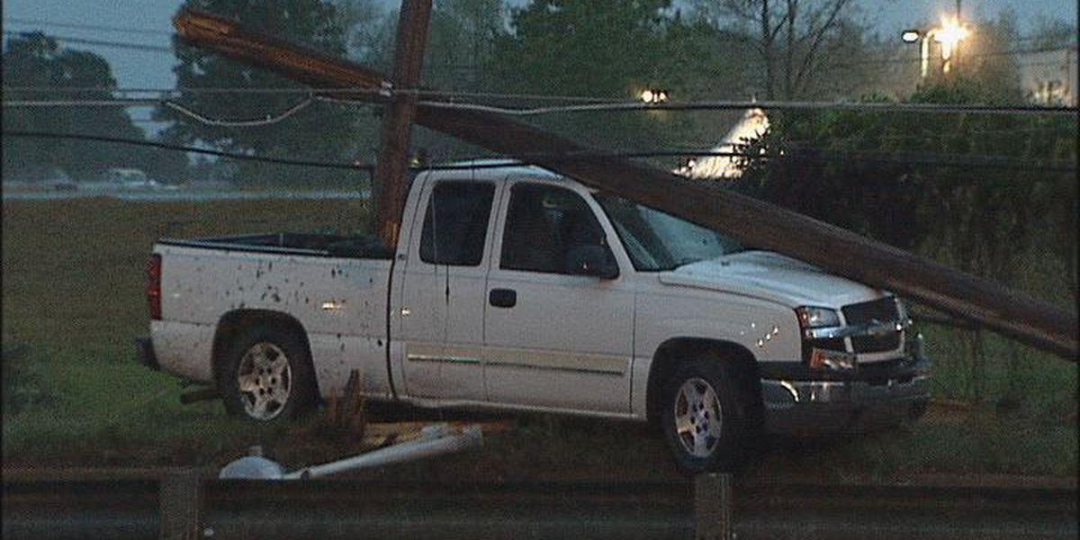 Truck slams into utility pole