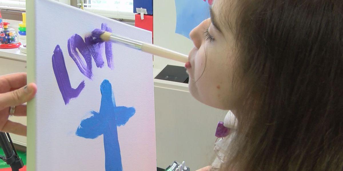 Quadriplegic artist auctions work, gives profits to hospital