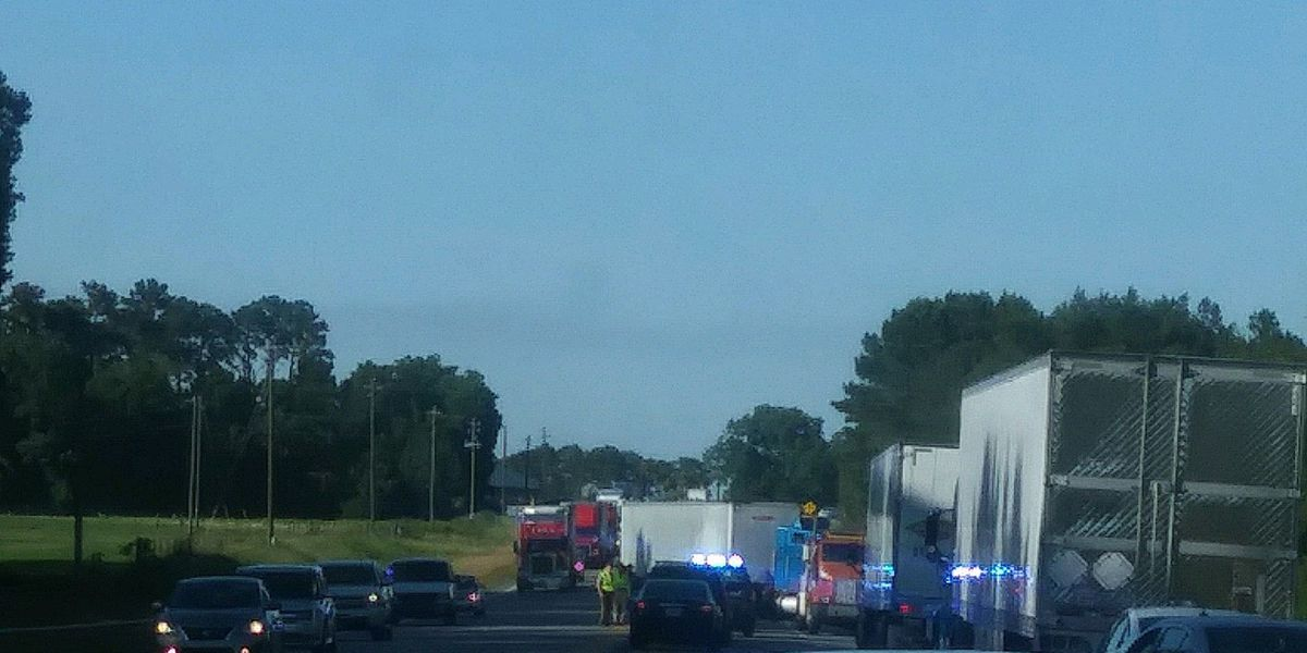 Omega officer injured in crash with semi-truck on Highway 319