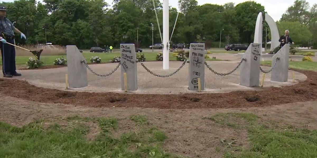 Vietnam War memorial tagged with graffiti in Boston; American flags thrown in creek