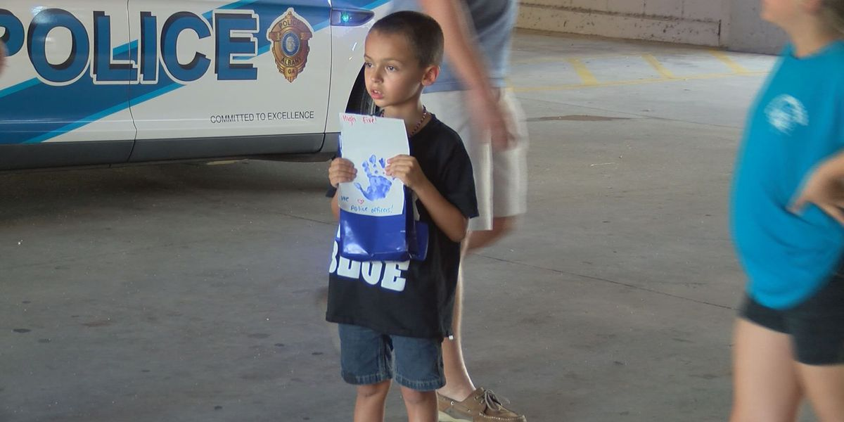 Kids hand out goody bags to local officers