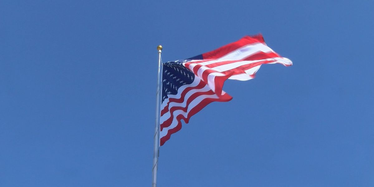Tift Co. erects, dedicates flag pole