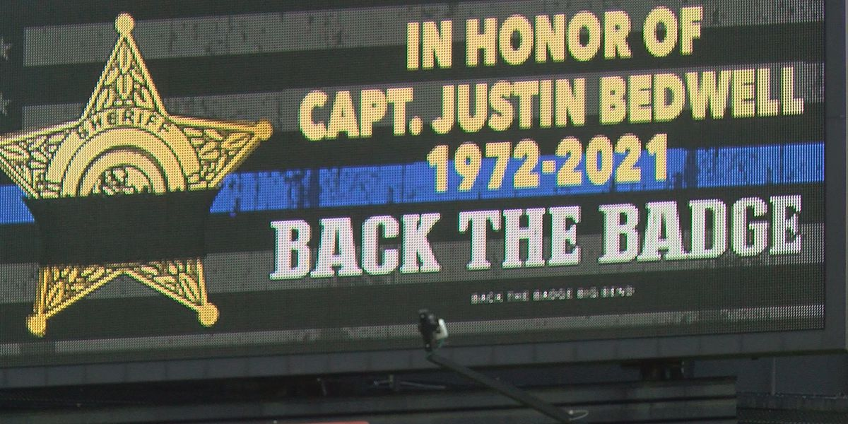 Sheriff, family of slain Decatur Co. lawman gather for billboard lighting ceremony