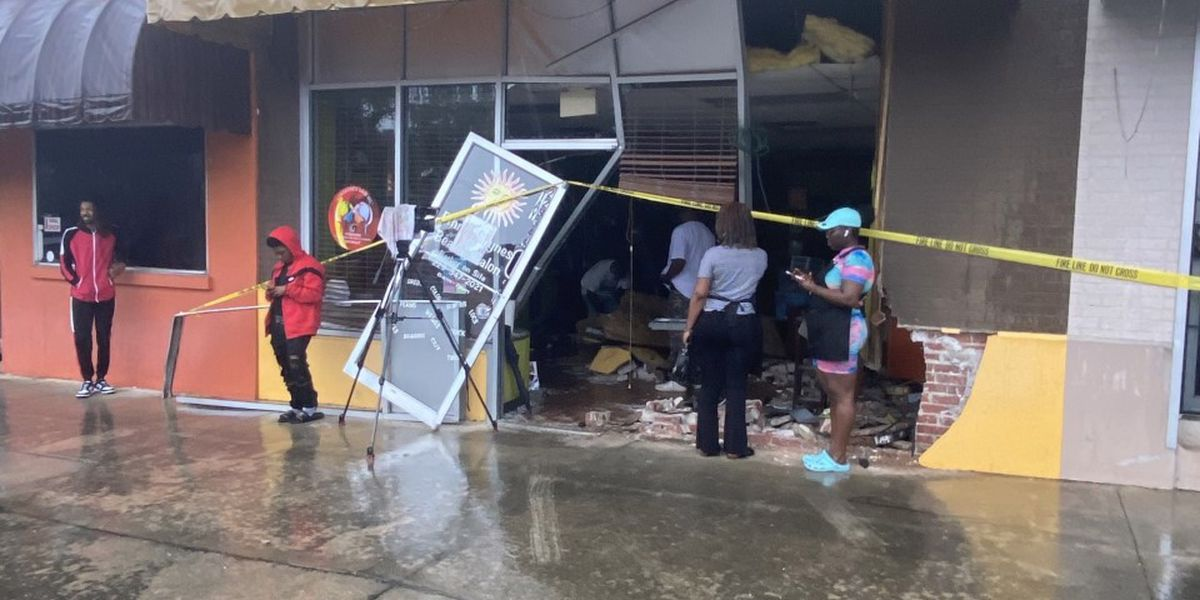 Car drives through Albany salon