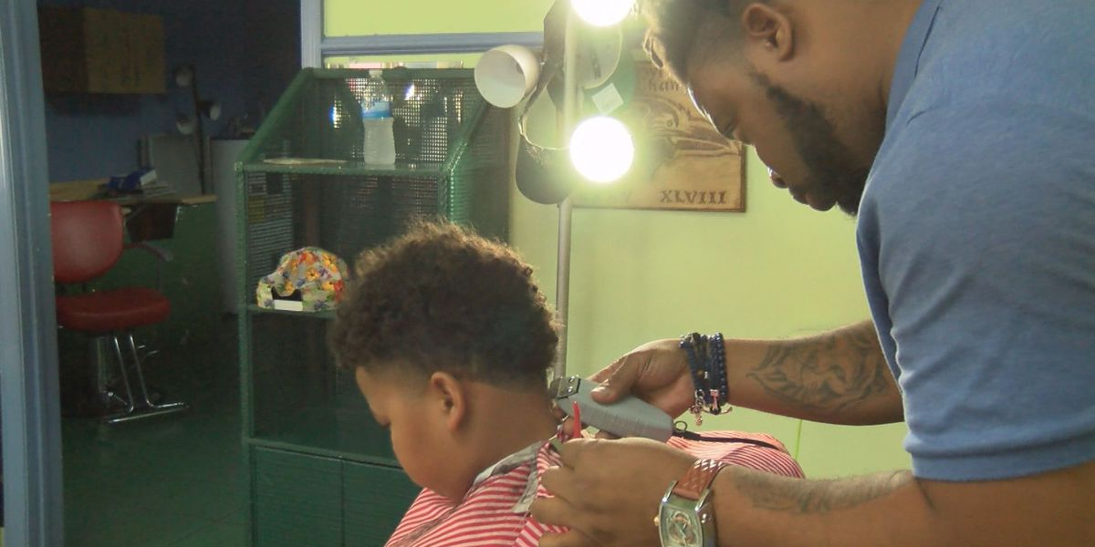 Albany barber hosts back-to-school barbecue