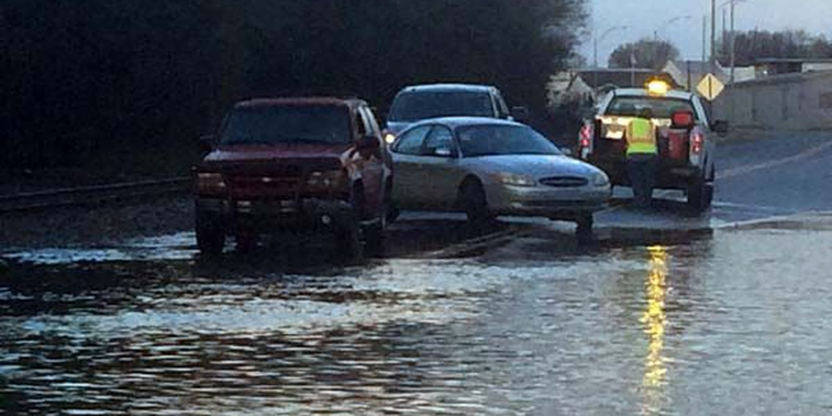 Folks try to drive through standing water