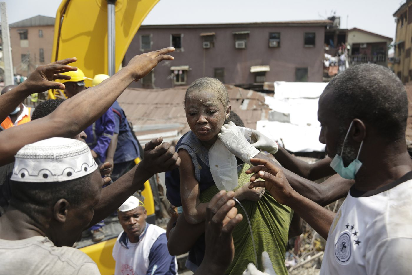 427dd13c6383f A child is rescued from the rubble of a collapsed building in Lagos