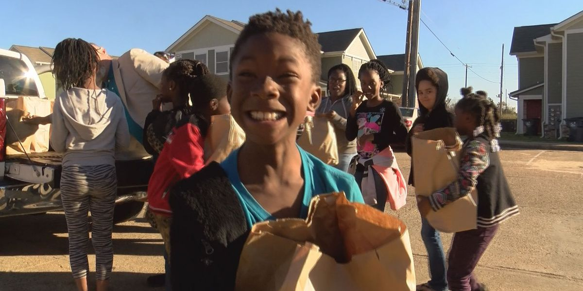 Motorcycle clubs collect canned goods for Thanksgiving