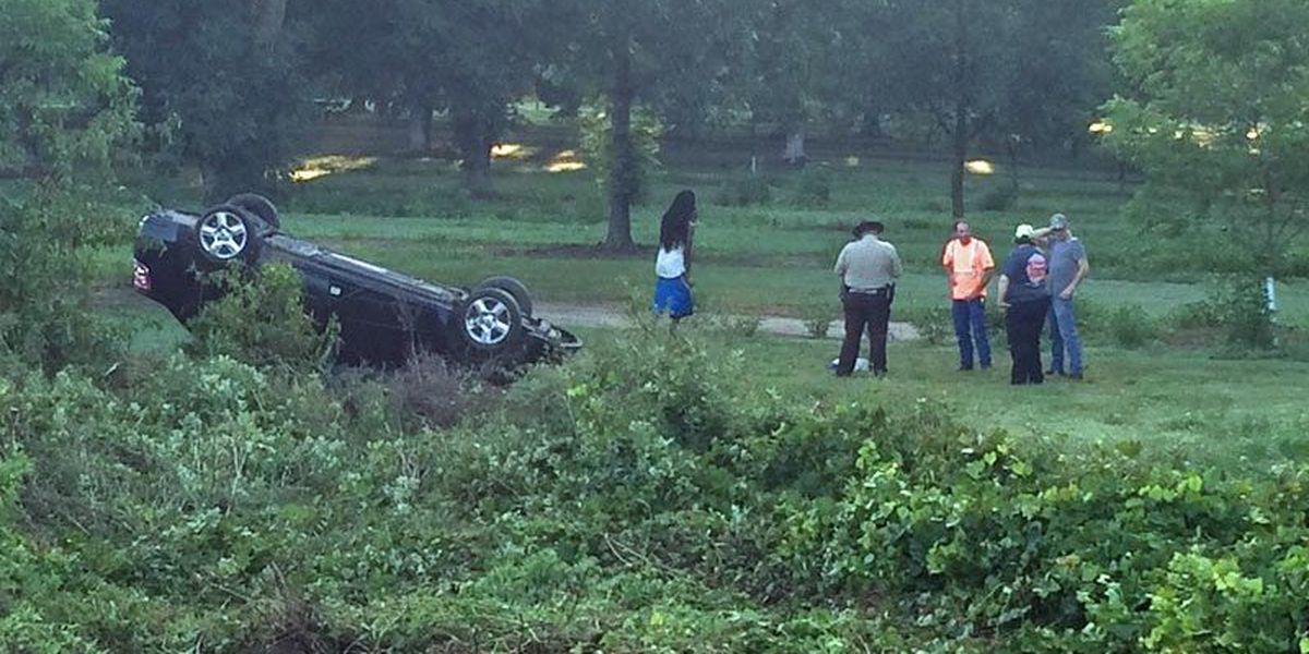 Driver overturns, avoiding package that fell off truck