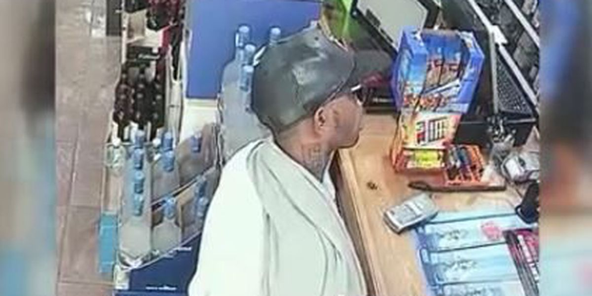 Surveillance shows robber pepper spraying clerks, police look for suspect