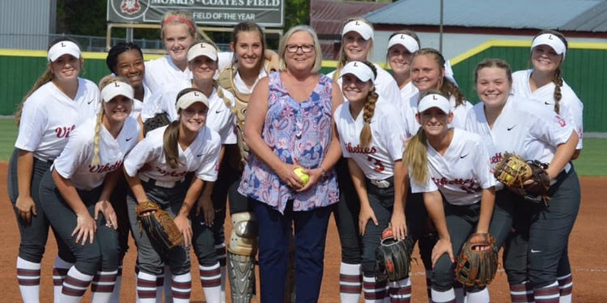 Lowndes High honors teacher, throws first pitch at softball game