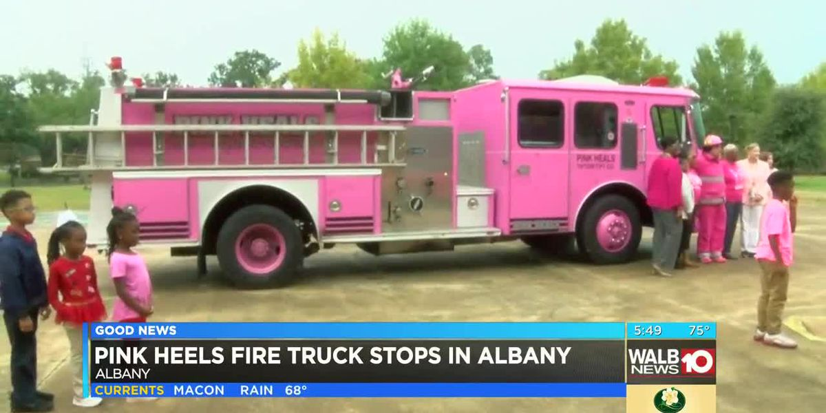 Pink Heels fire truck brings smiles to students, cancer survivors