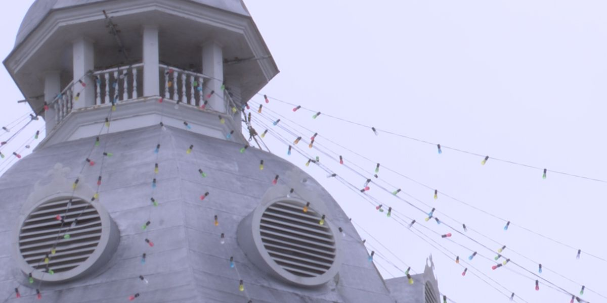 Crews setting up Canopy of Lights in Downtown Moultrie