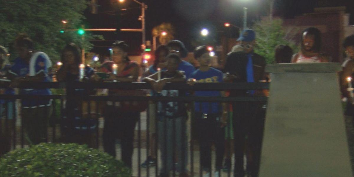 Friends hold vigil for homicide victim