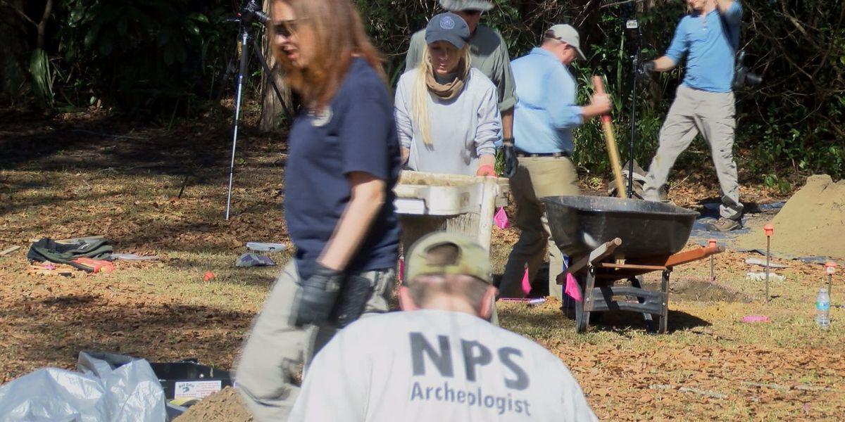 Archeologists and FBI agents search for human remains