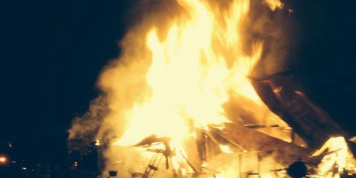 Massive New Year's Eve fire seriously injures woman, consumes house