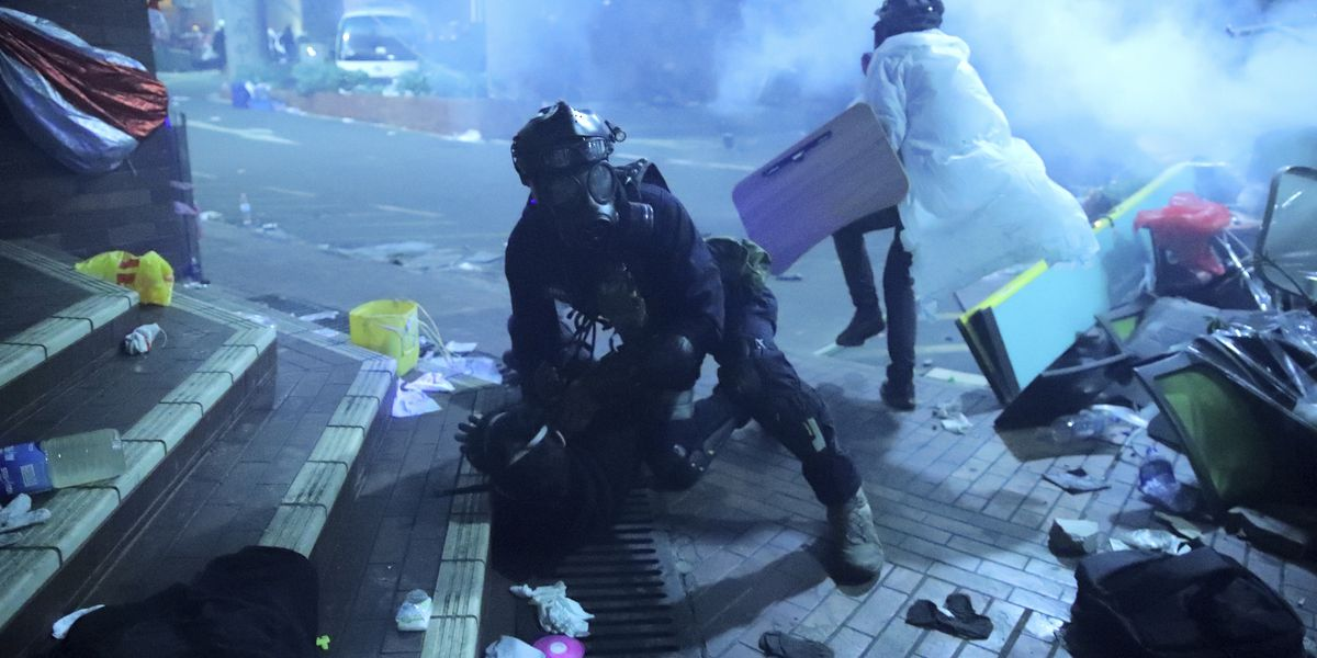 Hong Kong police storm university held by protesters