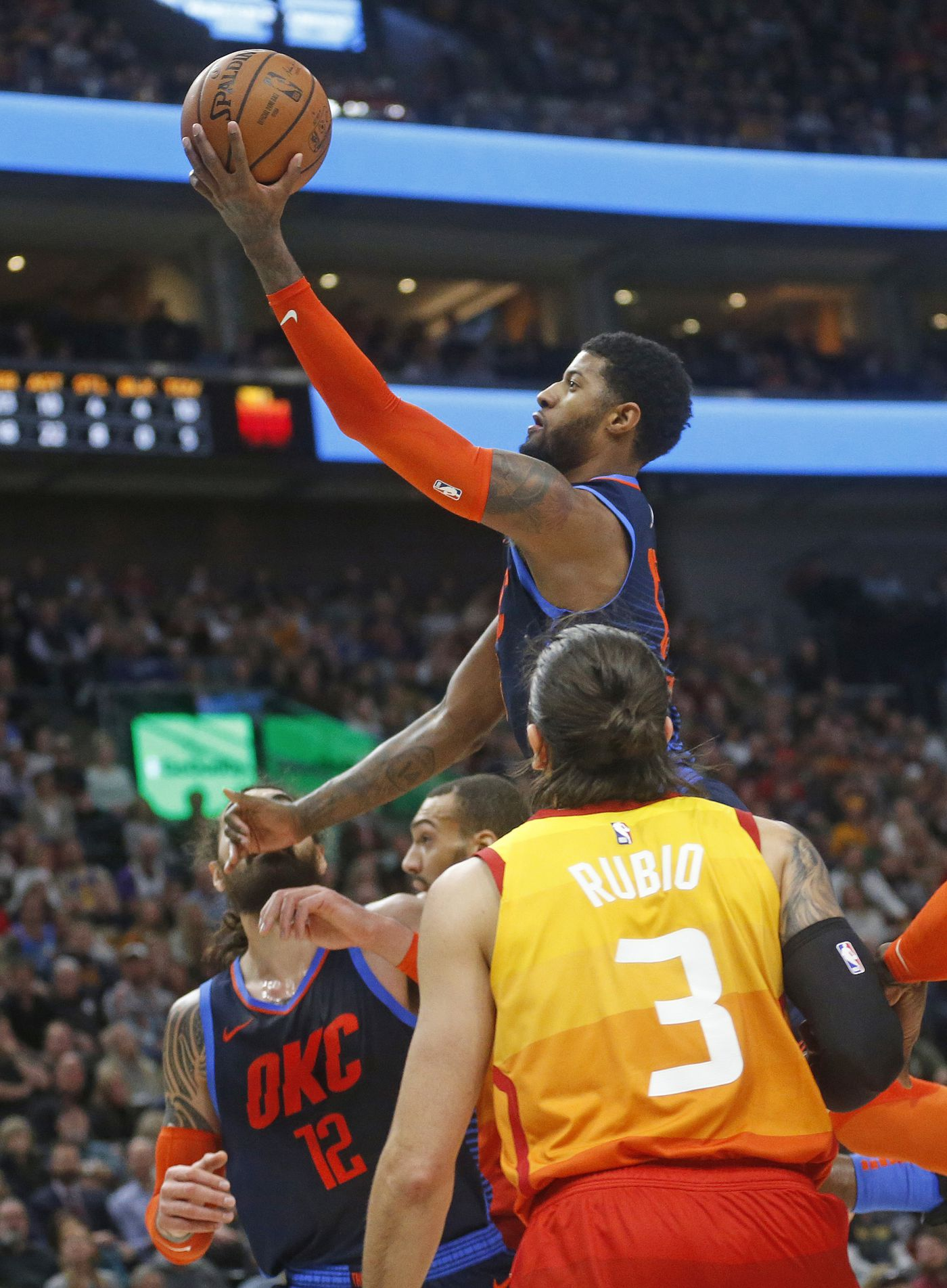 57c416af9d0 Oklahoma City Thunder forward Paul George goes to the basket as Utah Jazz  guard Ricky Rubio