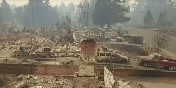 Firefighters begin to see progress against deadly California blazes, as death toll rises to 59
