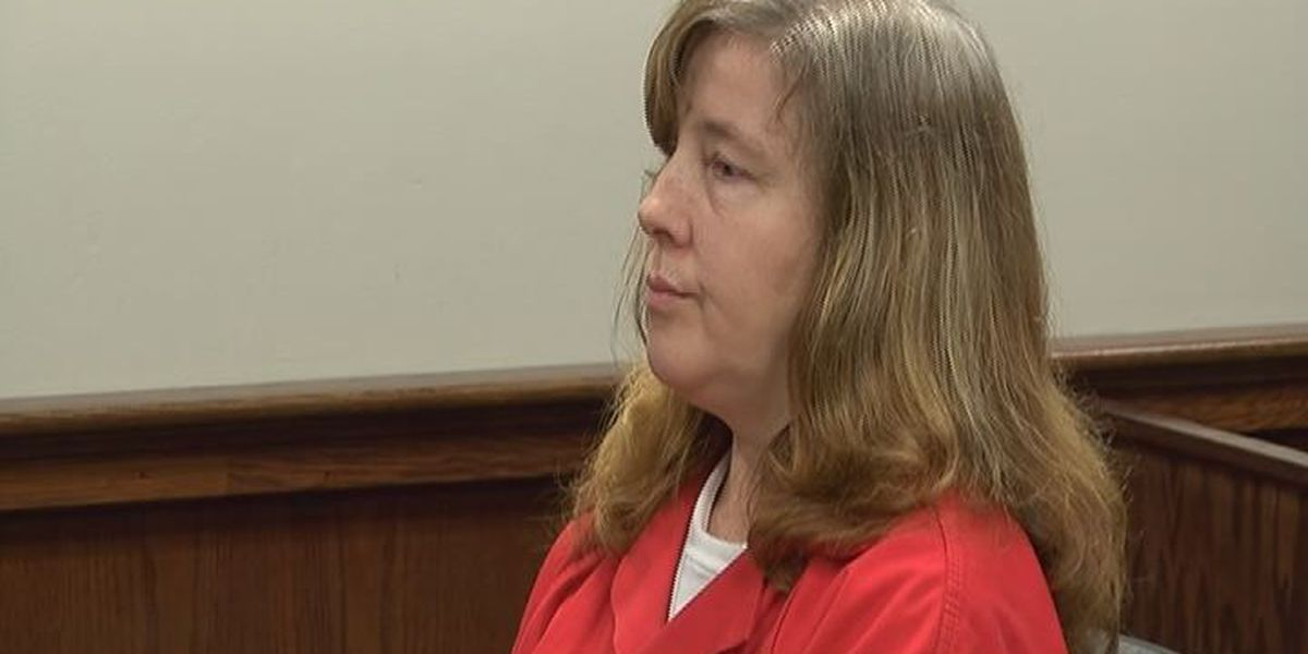 Status hearing set for woman accused of killing her husband