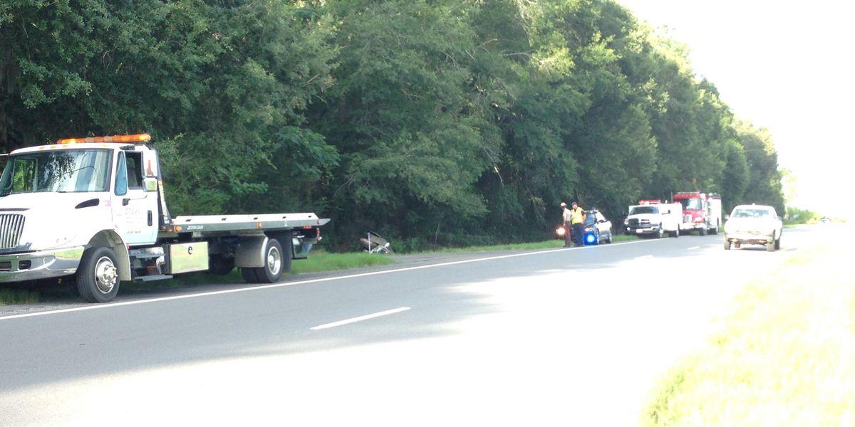 Car flips over on highway