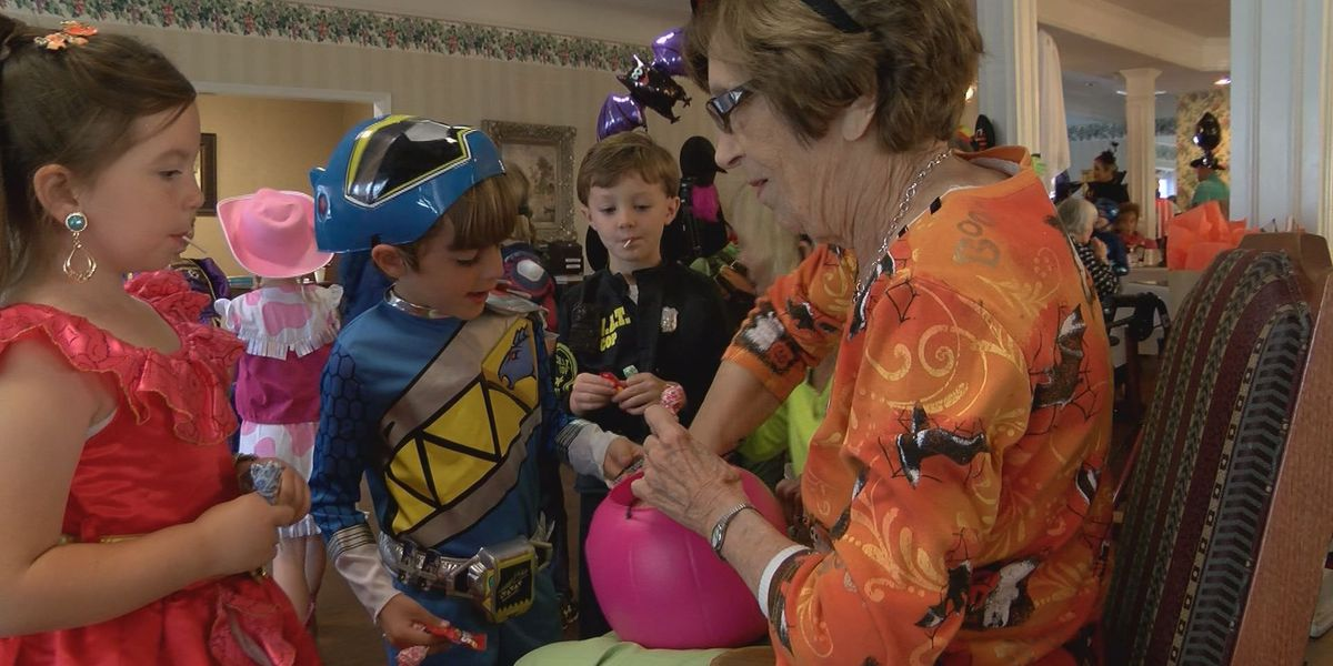 Students take trick-or-treating to senior living facility