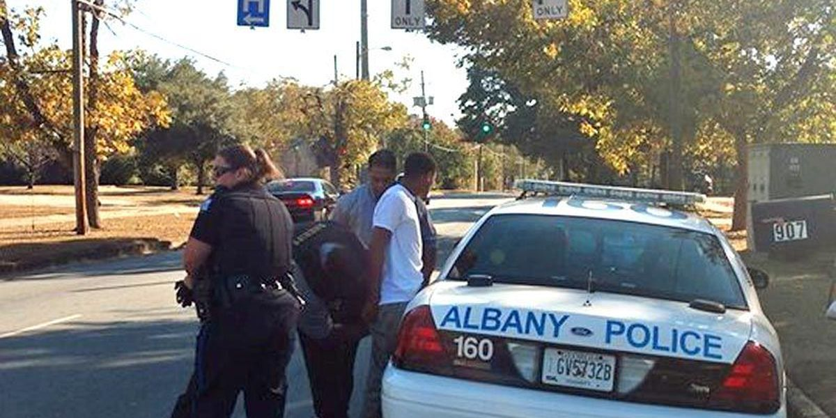 2 charged with harboring after Albany standoff