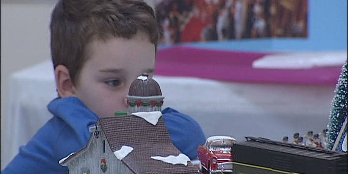 Young people enjoy model train show