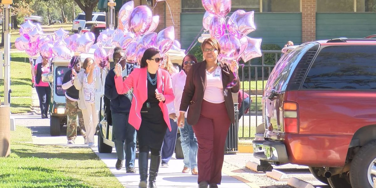 Breast cancer support group walks for awareness