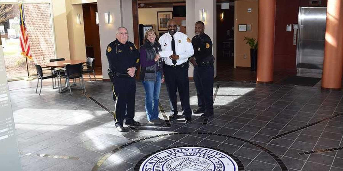 ASU police donate to Liberty House of Albany