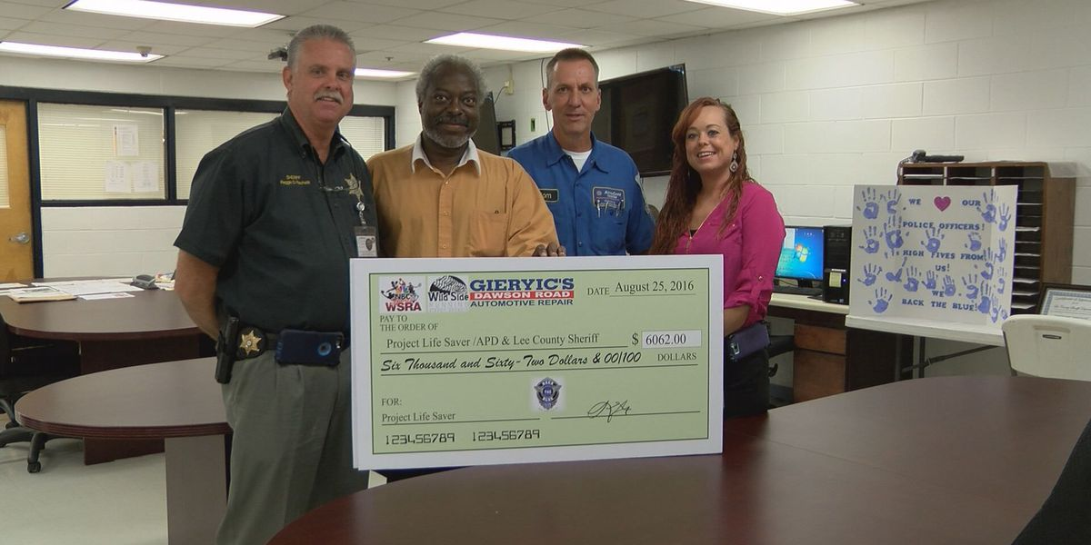 Two agencies presented with funds to buy tracking devices
