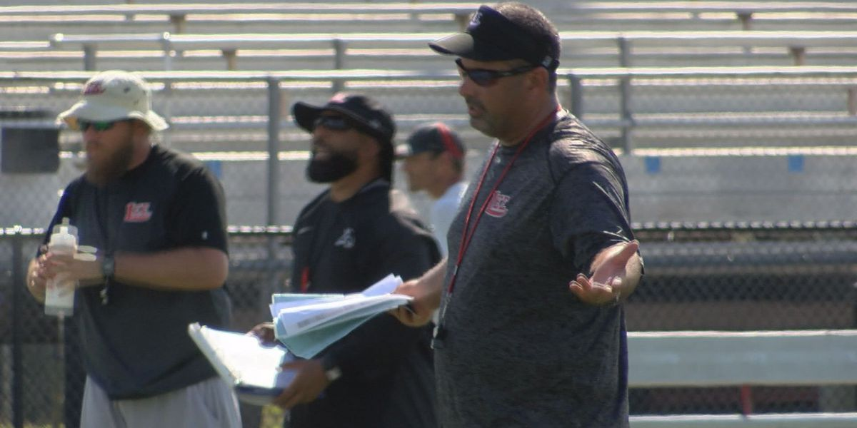 New-look Trojans downplaying state title defense