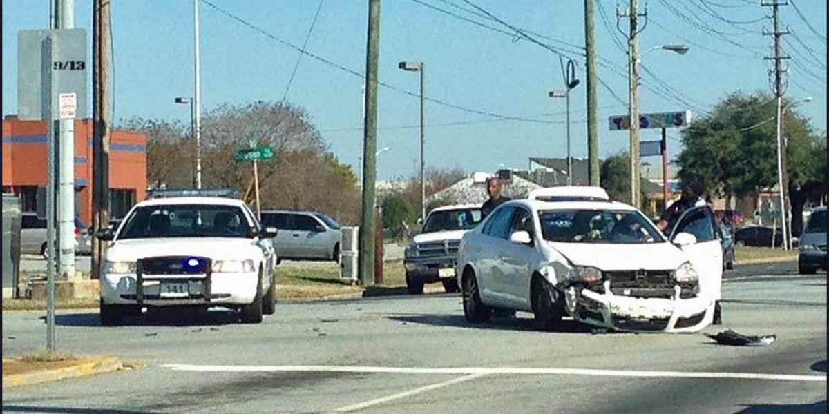 Vehicles wreck near Mall