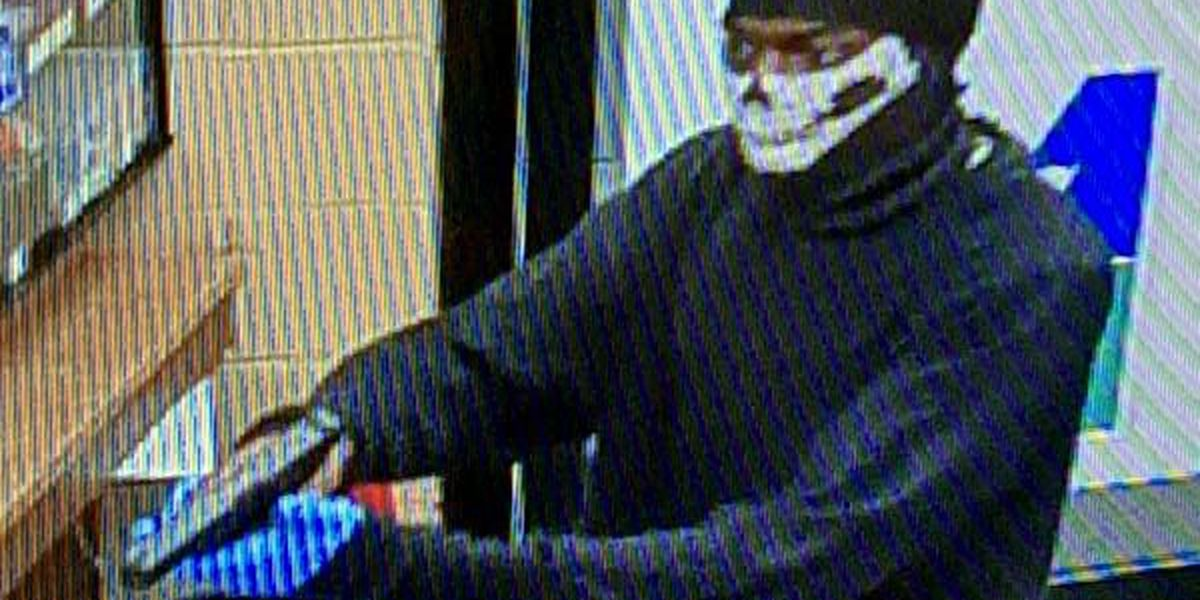 DCP shows photos of Flash Foods robber
