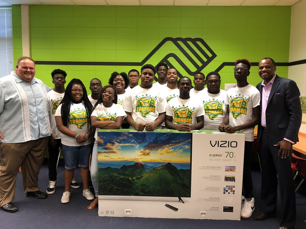 Monroe marching band members make donation to Boys & Girls Club