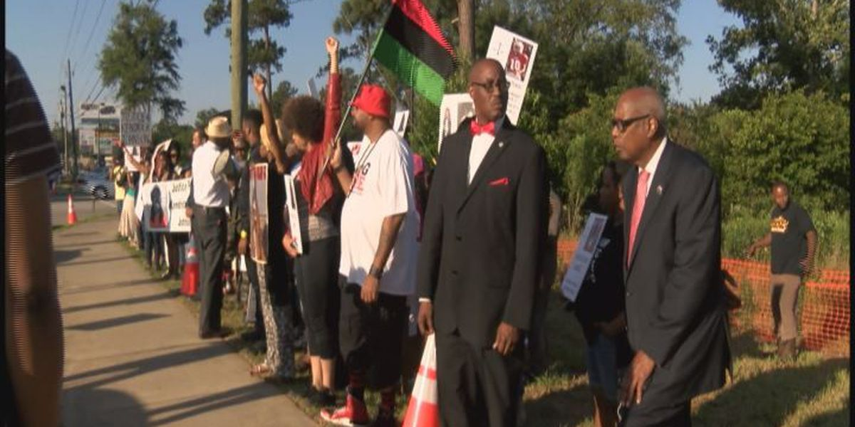 Protesters chant outside Lowndes High School graduation for Kendrick Johnson family